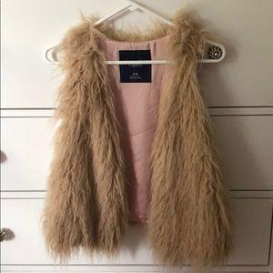 American Eagle fur vest